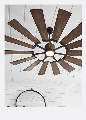 wooden blade ceiling fan on a white wooden ceiling