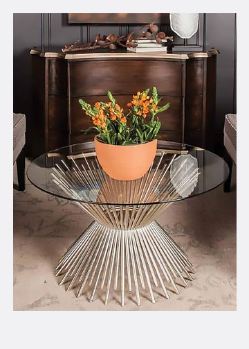 modern metalic coffee table with a glass top and a terracotta flower pot