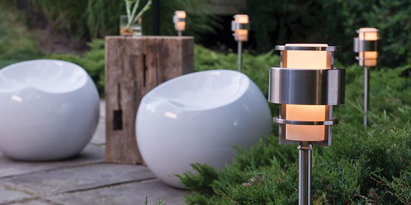 how to choose outdoor lighting - post lights in a garden at night beside plants