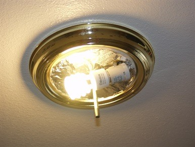Light bulb screwed into light fixture and on
